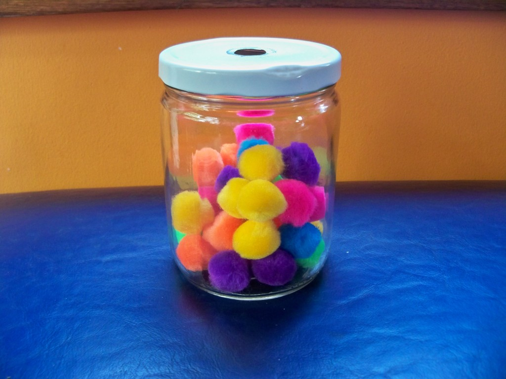 pom poms: awesome, inexpensive items to add to your toddler's toy shelf