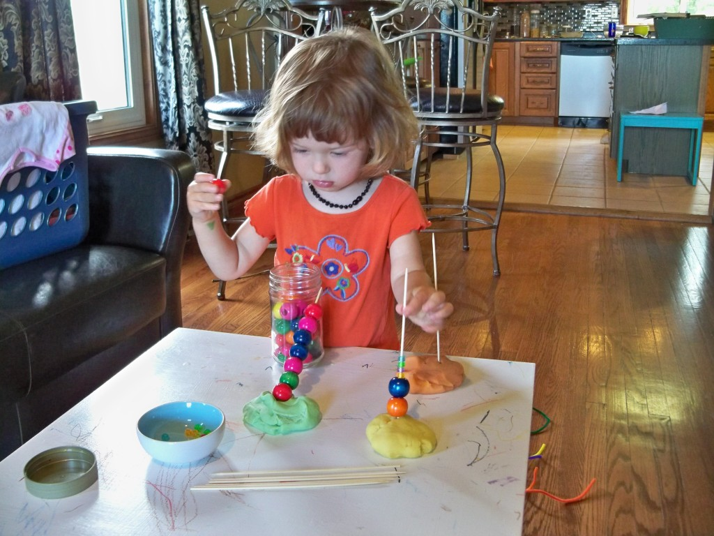 play dough, beads, and wooden skewers