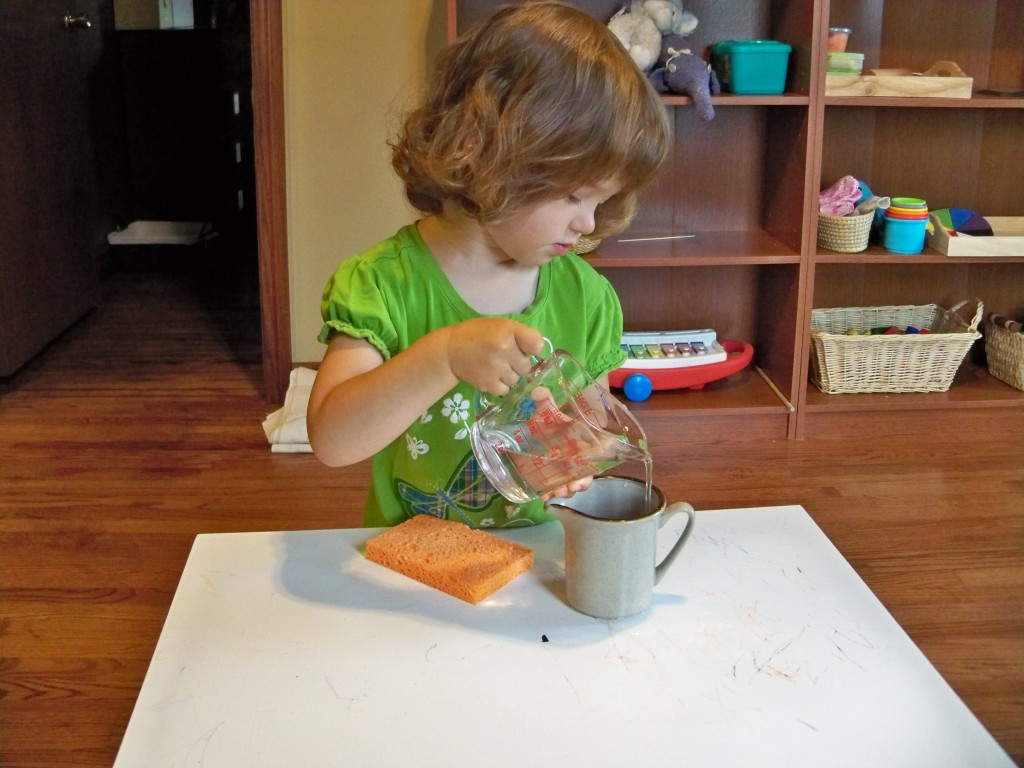 pouring water - montessori practical-life activities for a toddler