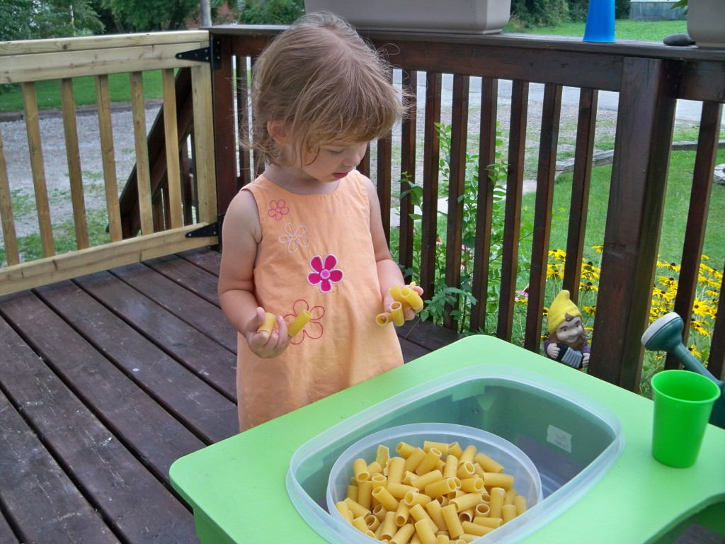 big noodles in sensory table