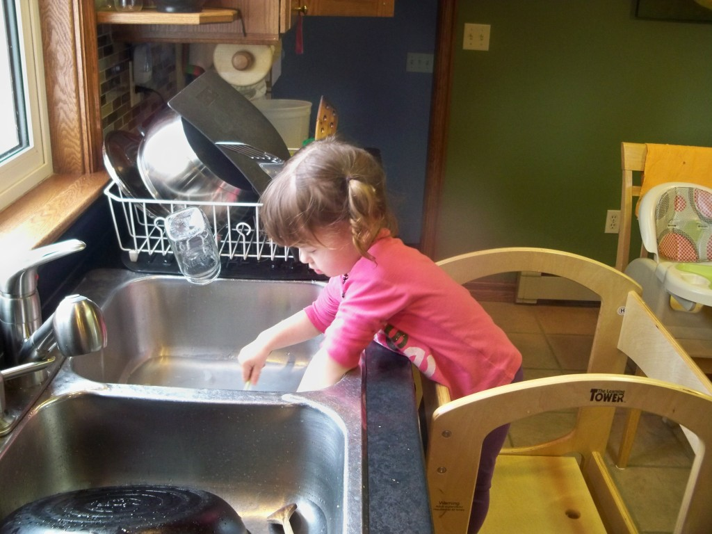washing dishes in learning tower