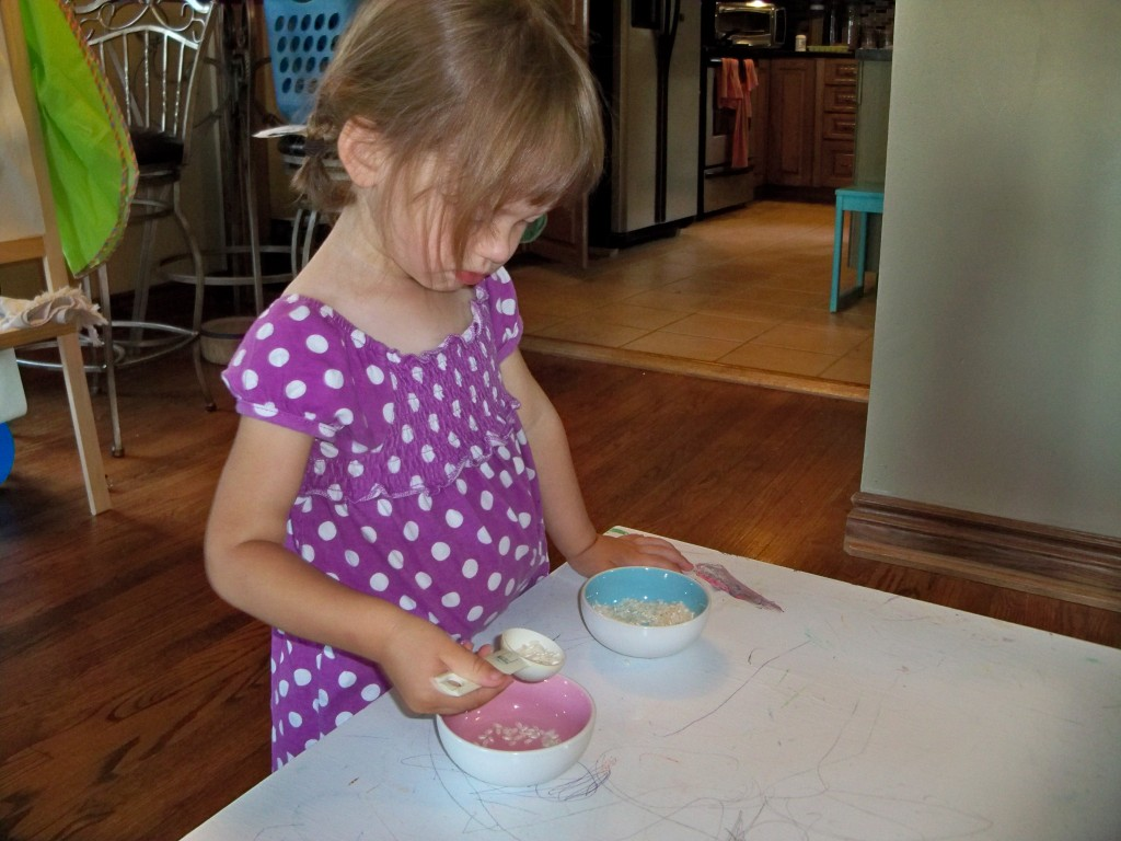 transferring rice - montessori activites for a toddler