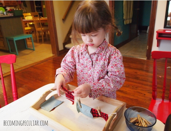 Practicing hanging clothes on a clothesline: Montessori activities for a two-year-old