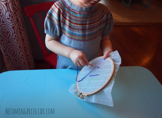 Sewing on an Embroidery Hoop: 14  Montessori activities for a two-year-old