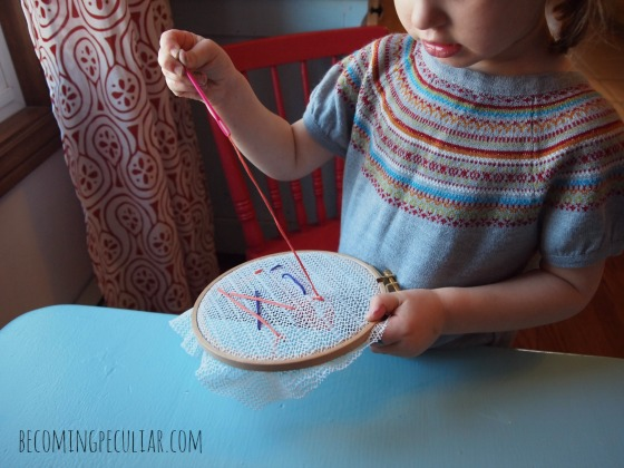 Sewing on an embroidery hoop -- 14  Montessori activities for a two-year-old