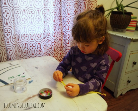 Stringing beads onto pipe cleaners: Montessori activities for a two-year-old
