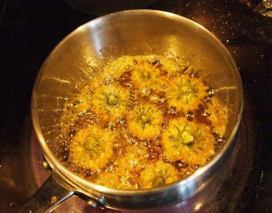 Frying tempura dandelions
