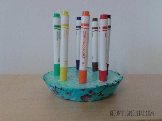 marker holder made with plaster of paris. Keep markers off the floor and capped!