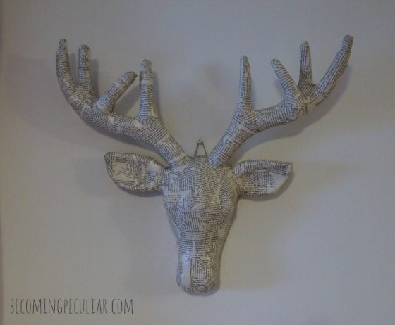 paper mache deer head with book pages